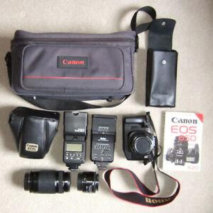 35mm SLR  Canon EOS camera + telephoto lens + wide angle lens + 2 flash guns