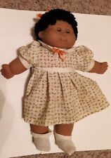 Vintage Cabbage Patch Doll with eyes that open and close.