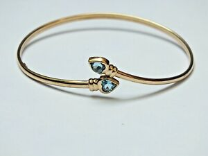 Vintage 9ct yellow gold Torque style bangle with Blue Topaz