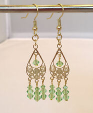 Chandelier Earrings, Gold plated with Light Green Crystals. 2 3/8 inch.