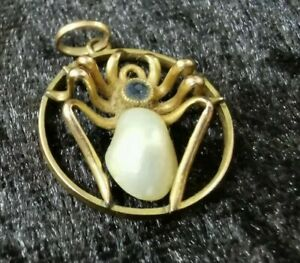 EARLY 1900S SPIDER PENDANT 9CT GOLD, SAPPHIRE AND REAL PEARL BODY 1 GRAM