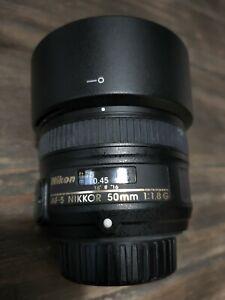 Nikon NIKKOR AF-S 50mm f/1.8G + Pare-soleil HB-47