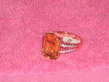 FASHION JEWELRY - EMERALD CUT SPARKLING RING - AMBER WITH SIDE STONES: SIZE 7