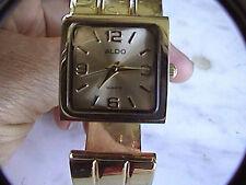 aldo gold tone cuff bracelet women's wrist watch