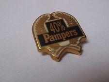 pin's couches pampers (trophée 40% du marché) zamac doré signé Métargent