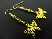 A PAIR GOLD TONE DANGLY BUTTERFLY   EARRINGS. NEW.