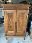 Antique 1900s Indonesian solid teakwood hand carved cabinet