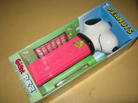 Snoopy Peanuts collectibles giant PEZ dispenser plays music snacks wrapping roll
