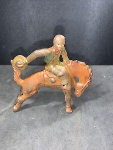 vintage gray iron cast iron cowboy mounted on bucking horse dimestore