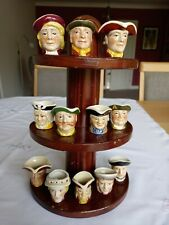 More details for miniture toby jugs x 12 and stand wood potter vgc post uk only