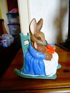 Vintage cast iron nursing rabbit wedge doorstop