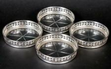 SET OF 4 BIRKS STERLING COASTERS WITH GLASS BOTTOM