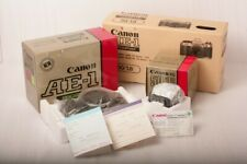 Boxed Canon AE-1 program camera with its Canon fd 50mm 1.8 lens in retail box