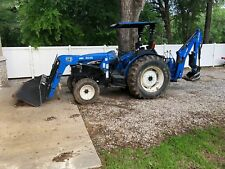 New Holland Tractor TN65 with Loader and Backhoe 700 hours. Excellent