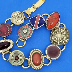 Art nouveau cufflink with pops of Red