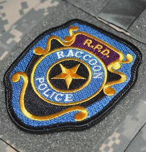 RESIDENT EVIL ZOMBIE WORLD WAR Z PROP ID BADGE INSIGNIA: RACCOON CITY R.P.D
