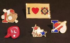 4 Little League baseball pins with an extra Babe Ruth pin