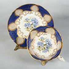 PARAGON TEACUP & SAUCER - WHITE/ROYAL BLUE WITH FLORAL CENTRES & LOTS OF GOLD