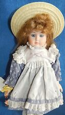 """porcerlain girl doll 14 """" with pinafore and straw hat. and stand"""