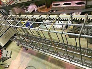Rebar cage manufacturing frames