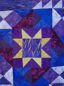 Gold Metallic Stars and Purple Pinwheels Quilt