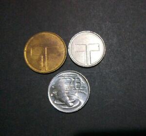 2 tokens : 1980 Telecom Tower Canberra & smaller silver coloured Telecom token