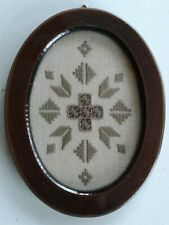 Embroidered geometric picture in oval wood frame