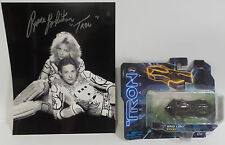 TRON : TRON PHOTO SIGNED BY BRUCE BOXLEITNER WITH GRID LIMO DIE CAST MODEL