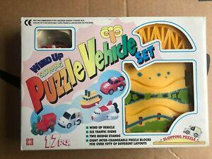 Wind Up Sloping Puzzle Vehicle Set