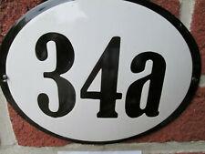 Hausnummer Oval Emaille schwarze Zahl Nr. 34a  weißer Hintergrund 19 cm x 15 cm