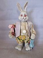 Easter bunny rabbit made if resin with paper or cloth clothes