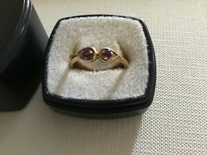 9 ct gold hallmarked ring with 2 small amethysts, size 0