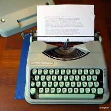 1961 Hermes Rocket ultraportable typewriter w/case and new ribbon, working well.