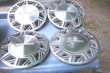 OEM set of 4  14 inch wheelcovers# 854 1987-88 Mercury Cougar 36 hole type