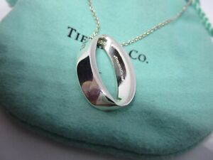 Genuine tiffany and co sterling silver rare flattened oval pendant and chain