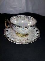 Intricate gold swirl bone china cup and saucer