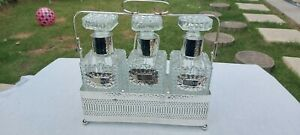 A Vintage silver plated Queen Ann Decanter Set With Stand and labels.ornate.
