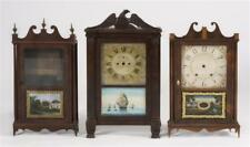 Three Clock Cases Two pillar and scroll clock cases in mahogany and ma. Lot 14