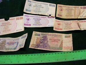 Lot of  7 diff.  very used(dam... ZIMBABWE Banknotes..Multi-millions dollars.
