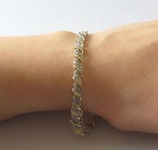Secondhand 9ct Yellow Gold Multi Diamond Swirl Bracelet (7 1/2 inches).