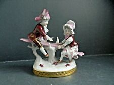 RUDELSTADT VOLKSTEDT CHILDREN ON SEESAW FIGURINE