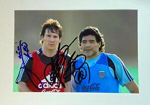 Autogramm von Messi & Maradonna