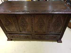 Early 18th Century Queen Anne carved and paneled oak mule chest.