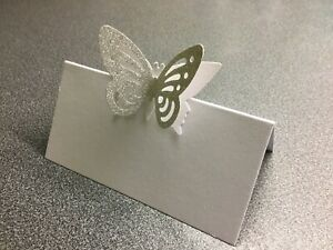 10 White Name Place Cards With A White And Silver Glitter Butterfly