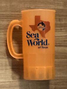 """VINTAGE - Sea World Of Texas Plastic Souvenir Mug Cup in Orange 7.5"""" Tall - USED"""