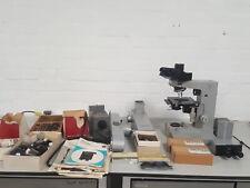 Microscopio Leitz Ortholux + Accesorios oculares, objetivos, doble cabezal de visualización