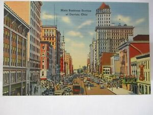 "1940 POSTCARD  "" MAIN BUSINESS SECTION OF DAYTON OHIO "" STORE FRONTS BILLBOARDS"
