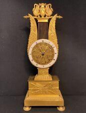 Rare pendule empire Lyre en bronze doré. (French ormolu Clock)