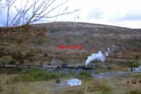 PHOTO  SOUTH AFRICAN RAILWAYS - A PASSENGER TRAIN BEHIND A PAIR OF 4-8-2S ONE FR