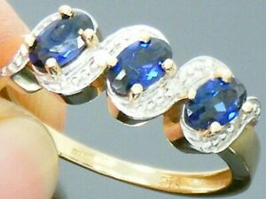 9ct  yellow solid gold diamond and created sapphire Hallmarked ring size M